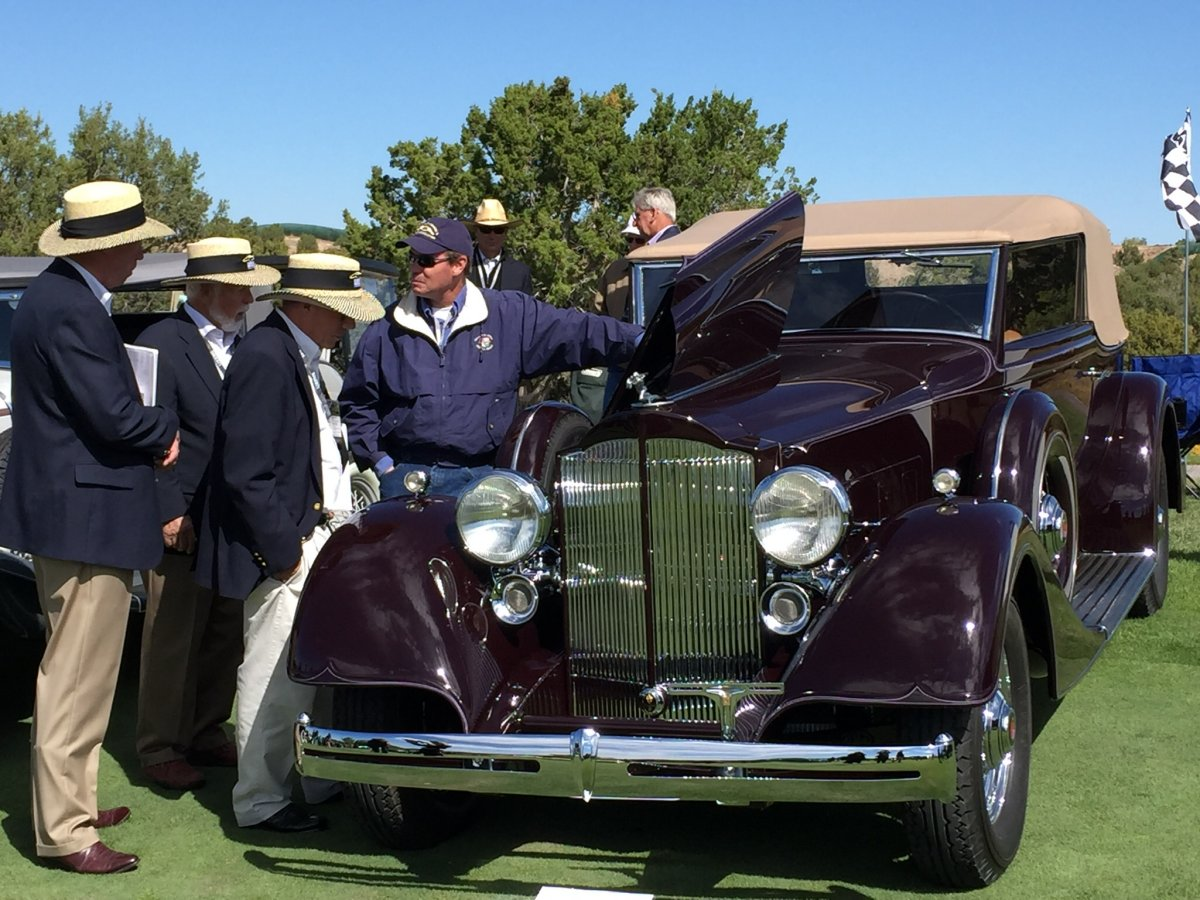 Photo of a 1934 Packard Standard 8 being judged at a car show.